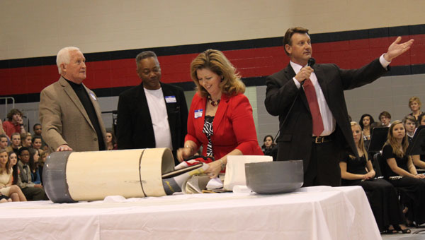 Former Principal Larry Simmons, former Assistant Principal Bobby Harris, 1989 SGA President Dana Daniel Blake and 1988 SGA President Brian Lee open the 25-year-old time capsule at Thompson High School Jan. 25. (Reporter photo/Christine Boatwright)