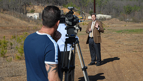 Aronov Vice President of Development John Argo, right, visits the future site of the Alabaster Exchange shopping center during a 2012 television filming. (File)