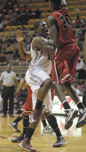 Shelby County senior Tyler Madison drives the lane for two of his game-high 24 points in the Wildcats' 50-47 victory in the Class 5A Central Region semifinal at Alabama State University. (Reporter photo/Mickel Ponthieux)