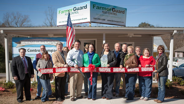 From left, at the ribbon-cutting ceremony for FarmerGuard Pest Control are, front row, Leigh Hulsey, Mayor Mark Hall, Alan Farmer, J.J. Farmer, Kim Cato, Jim Wathen, Mary Lou Vonderau, Leslie Bartlett, and Cris Nelson. From left, back row, are Hal Woodman, Pastor Lyle Holland, Amanda Traywick, Kim Miller, Henry Neff, Chris Vondera and Bob Van Loan. (Contributed)