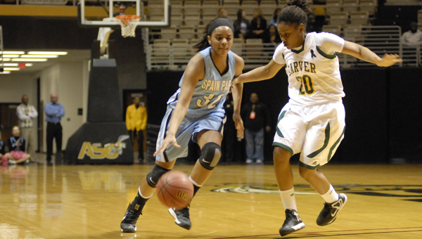 Spain Park's Victoria Baldwin drives to the basket in the first half of the Lady Jags' 47-31 loss to Carver-Montgomery in the Class 6A Central Region semifinals Feb. 20 at Alabama State University. (Reporter photo/Mickel Ponthieux)