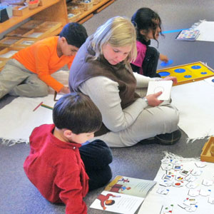 Montessori preschool teacher Jennifer Pope and students learning by doing. (Contributed)