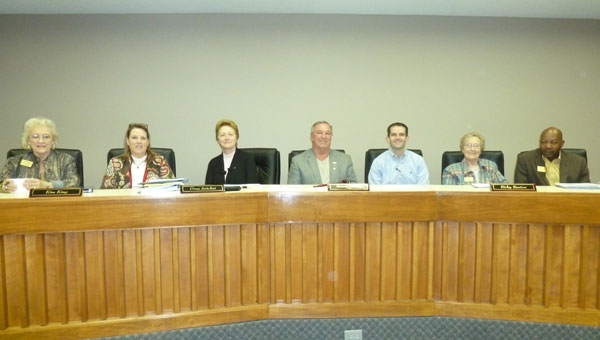 The City Council at work, from left, Ouida Mayfield (District 5); Kim King (District 4); City Clerk Gina Antolini; Mayor Dr. Stancil Handly; Ricky Ruston (District 3); Barbara Moore (District 2) and Leslie Whiting (District 1). (Contributed)