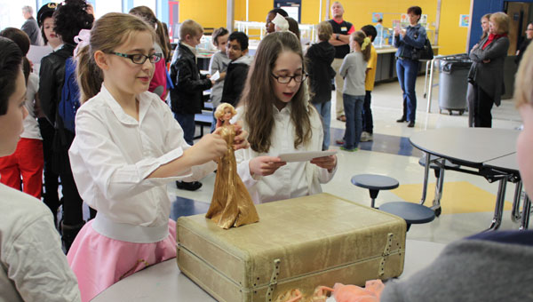 """Emily Teel and McKenna Youngblood teach their audience about Marilyn Monroe's life in the 1950s at CIS' """"Rock Around the Clock"""" sock hop Feb. 20. (Reporter photo/Christine Boatwright)"""