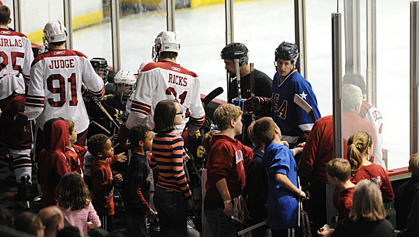 Fans greet the University of Alabama Frozen Tide hockey players as they come off the ice during a recent game at the Pelham Civic Complex. The Frozen Tide is preparing to travel to the national tournament in mid-March. (File)