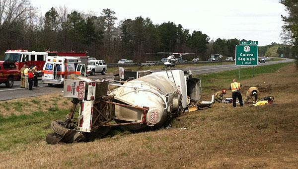 First responders work to clear an overturned 18-wheeler on I-65 in Calera on Feb. 28. (Contributed)