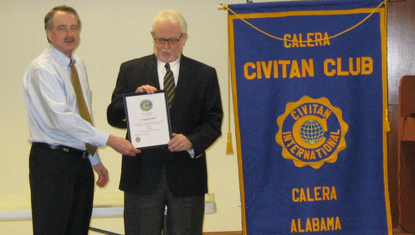 Calera Civitan Club President Larry Fikes presents an appreciation plaque to Central Alabama Community College Adult Education Director Bert Sims. (Contributed)