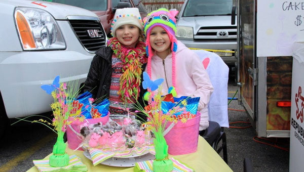 Juliana Swinford, left, 6-year-old daughter of Johnny Ray's owner Miranda Carter, and friend Kaitlyn Funk, selling Cakepops at a recent function. Juliana, who plans to become the youngest business owner in Shelby County, will be a vendor at Johnny Ray's Anniversary celebration on March 17. (Contributed)