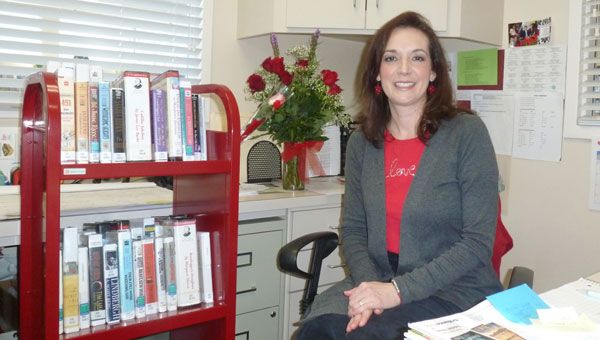 Columbiana Public Library's new director Dutcha Lawson in her office at the library. (Contributed)