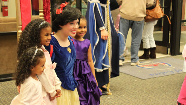Snow White, or Laura Grace Smedley, poses with little princesses at the Calera Library Fairy Tale Ball March 2. (Reporter photo/Christine Boatwright)