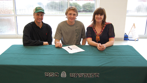 Oak Mountain senior Mills Sproull signed a soccer scholarship to play for the University of South Carolina Upstate. Mills is pictured with his parents Miller and Joy Sproull. (Reporter photo/Mickel Ponthieux)