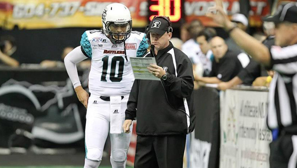 Shelby County native and Arizona Rattlers head coach Kevin Guy discusses the game plan with quarterback Nick Davila during ArenaBowl XXV. (Contributed/Bruce Yeung)
