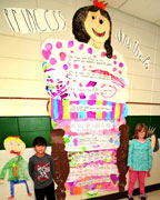Kolson Nemeth and Audrey Martin pose with the Princess and the Pea fairy tale that six students of Mrs. Andrea Burk's kindergarten class produced. (contributed)