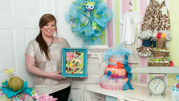 Rebecca Harris Sippola, owner of the newly-opened Beka's Boutique in Old Town, creates custom diaper cakes and wreaths in your choice of colors and motifs for new-baby celebrations, as well as perky patterned fabric flowers in pots.  (Contributed)