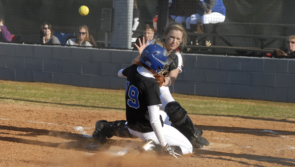 Montevallo's Savannah Upton slides into home plate at the feet of Shelby County's Jaselyn Harrison in the Lady Dogs 4-2 loss to the Ladycats March 27 at SCHS. (Reporter photo/Mickel Ponthieux)