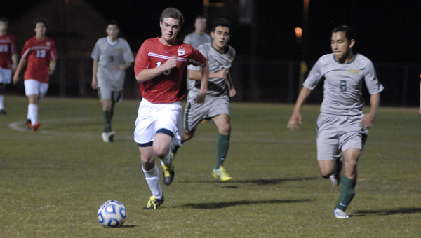 Oak Mountain's Clay McDonald chases down a ball in the first half of the Eagles' 2-0 area victory over Pelham March 29. (Reporter photo/Mickel Ponthieux)