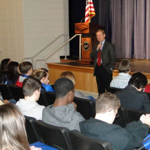 U.S. Rep. Spencer Bachus, R-Alabama, talks to Calera Eagle Marching Band members about government leadership and the importance of non-violent protest in the school auditorium on March 25. (Contributed photo/Mollie Brown)