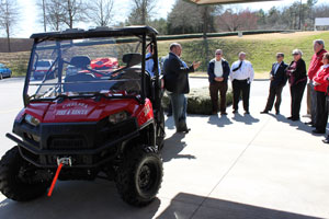 Firehouse Subs Co-Founder Robin Sorensen presents the ATV to the Chelsea Fire Department March 13. (Reporter photo/Christine Boatwright)