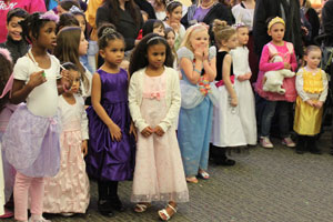 Little princesses watch as their favorite Disney princesses and characters dance. (Reporter photo/Christine Boatwright)