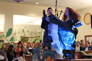 Bagpiper Dallas Key and Merida from Brave, or Chelsea Vonbartheld, perform at the Fairy Tale Ball. (Reporter photo/Christine Boatwright)