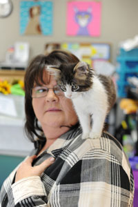 Sara Shirley, executive director of the Shelby Humane Society, holds Abigail Lilygirl, a shelter kitten. The Society's friends on Facebook named the kitten as part of a contest. She was quickly adopted.