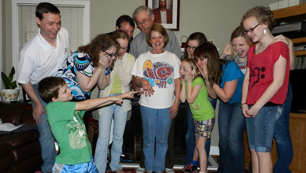 Mary Ellen Harmon, surrounded by her family, shows off her new Banks High School class ring in her Columbiana home March 17. (Contributed)