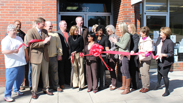 Members of the Shelby County Arts Council and the South Shelby Chamber of Commerce cut the ribbon for the SCAC's new performance space March 12. (Reporter photo/Christine Boatwright)