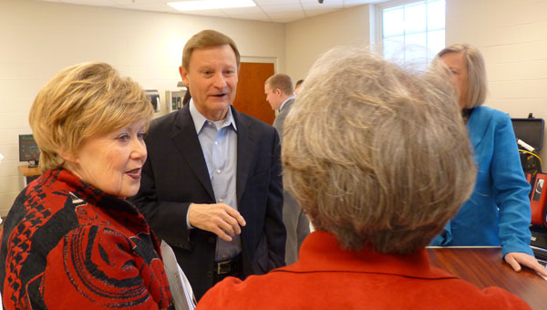 U.S. Rep. Spencer Bachus speaks with Jeff State President Judy Merritt, left, and other Jeff State employees during a tour of the college March 27. (Reporter photo/Amy Jones)
