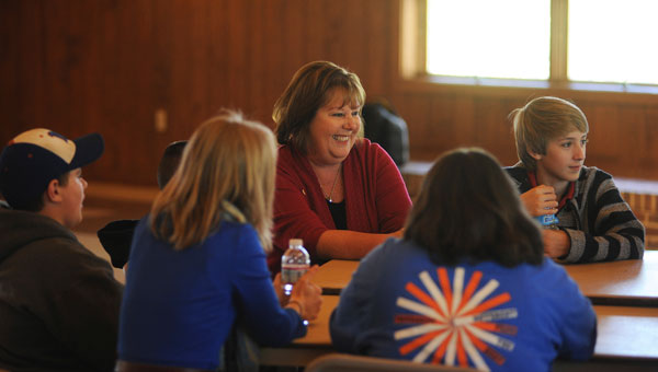 Carol Bruser chats with students from Montevallo Middle School during the Students' Civic Institute, sponsored by the David Mathews Center for Civic Life, on Nov. 15 at the University of Montevallo. (Reporter photo/Jon Goering)
