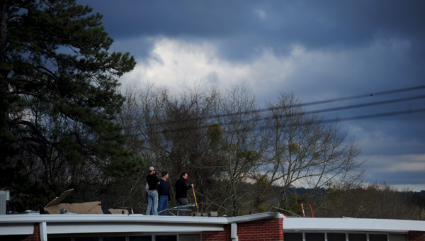 Workers repair damage to the roof of the Columbiana Middle School after storms rolled through on March 5. (Reporter Photo/Jon Goering)