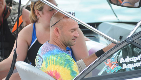Joe Ray prepares to take kids out on the water while working with Adaptive Aquatics. (File photo)