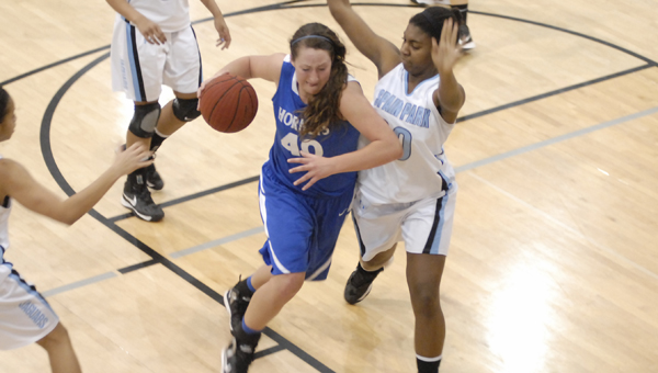 Chelsea senior center Amanda Mock drives to the basket in the Lady Hornets area tournament game against Spain Park. Mock is the 2012-2013 girls' basketball Player of the Year.