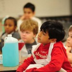 Ahmad Khan, a third grader at Riverchase Elementary, listens closely to a presentation during PhUn week on March 20. (Reporter Photo/Jon Goering)