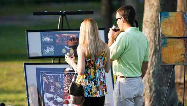 Guests at the 2012 Bark and Wine view items in the event's silent auction. (Contributed.)