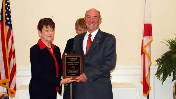 Susan Fulmer presents Herschel Hale with the Citizen of the Year Award at the the 35th Annual Montevallo Chamber of Commerce Citizens' Night Awards Banquet March 28. (Photo by Heather Buckner.)