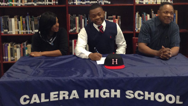Calera High senior JR Seay signed a baseball scholarship with Hillsborough College in Tampa, Fla. Seay is pictured with his parents Marilon and Bill Seay. (contributed)