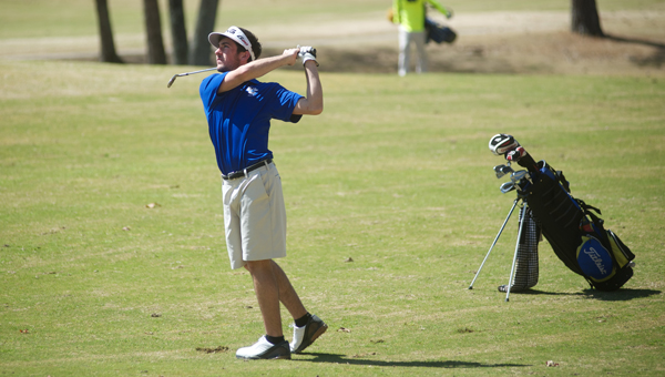 Chelsea's Reed Kelley watches a shot sail toward the green during the Shelby County Golf Tournament at Eagle Point on April 2. (Reporter Photo/Jon Goering)