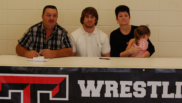 Thompson senior Nick Hall became the first Warrior wrestler to sign a Division I scholarship when he signed with Appalachian State April 18. Picutred with Hall are his parents Danny and Teresa Hall and his niece Kaitlyn Venable. (Reporter photo/Mickel Ponthieux)