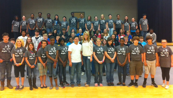 The Vincent Middle and High School choirs wearing their choir T-shirts with senior Logan Spradley, the only Shelby County student chosen in the Alabama All State Show Choir, and Vincent Choir Director Haley Spates standing front row center in white shirts. (contributed)