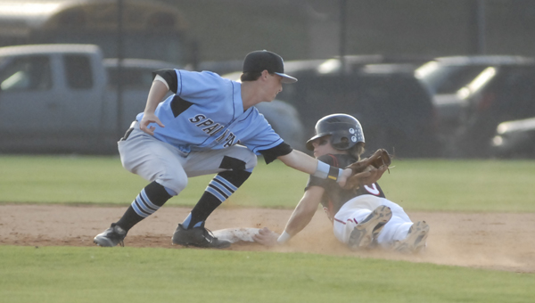 Spain Park second baseman Matt Berler puts a tag on Thompson's Davis Cox as he slides into second in the Jaguars' 9-6 victory April 22. (Reporter photo/Mickel Ponthieux)