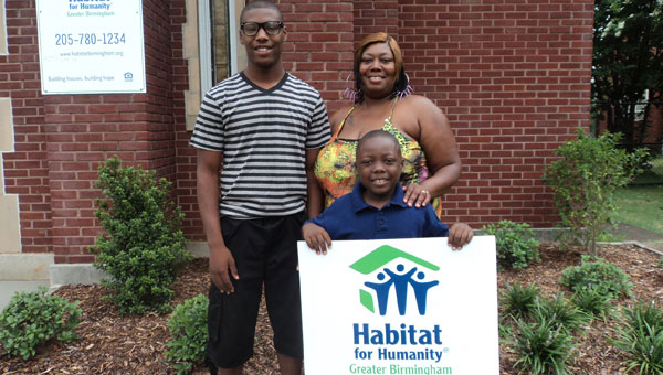 Thanks to Habitat for Humanity, Tilwana Conwell is a homeowner in the Shiloh Creek subdivision. Pictured with her are sons Demetrouse, left, and Jaquon. (contributed)