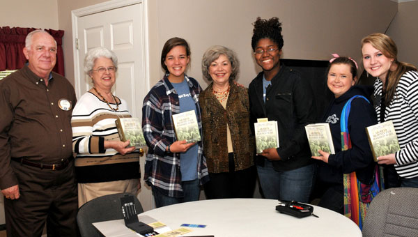 """Ruth Beaumont Cook, author of """"Guests Behind the Barbed Wire,"""" spoke to the Helena Kiwanis and Evangel Key Club members and signed copies of her novel. From left are Gene and Camille Maier, Lacey Entrekin, president of Evangel Key Club; Kayla Bailey, Emily Morris, president-elect of Evangel Key Club, and Brianna Farley, elected Lt. Governor for District 6 of Alabama District of Key Club International at a recent convention. (contributed)"""