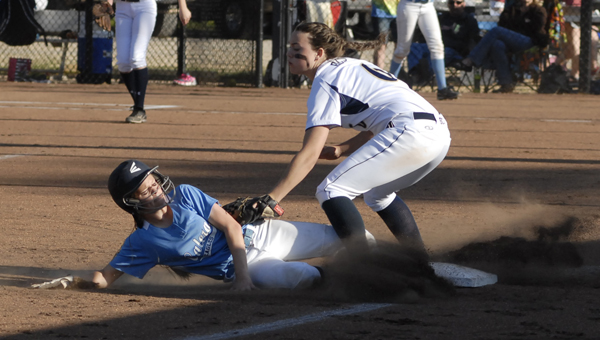 Calera's Shelby Clark slides under a tag from Briarwood's Madison Chambers in the Eagles' 10-9 nine-inning victory April 25. (Reporter photo/Mickel Ponthieux)