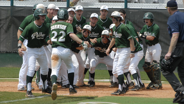 The Pelham baseball team welcome home Fletcher Johnson after his 3-run home run in the fourth inning of the Panthers' 9-1 game three victory over Spain Park April 27. (Reporter photo/Mickel Ponthieux)