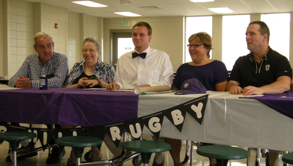 Pelham High School senior Connor Wilkins, center, signed the state of Alabama's first rubgy scholarship April 16 to Spring Hill College. (Reporter photo/Mickel Ponthieux)