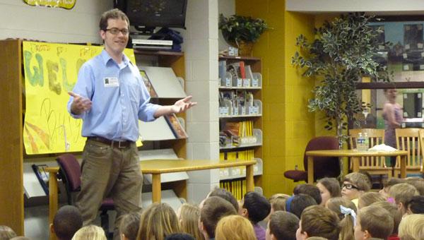 Author Burgin Mathews speaks to third-graders at Greystone Elementary School. (Reporter photo/Amy Jones)