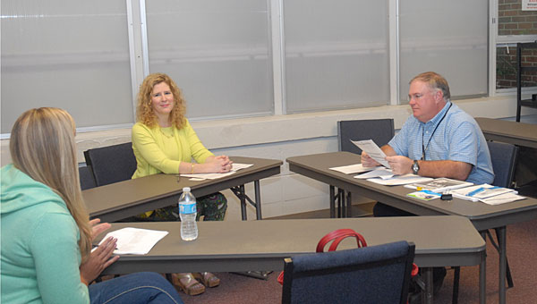 From left, Oak Mountain High School teacher Shelley Stanley, Deputy State Treasurer Glenda Allred and Shelby County Schools Schools to Career Resource Specialist Stan Brown attend an April 23 training seminar for a new personal finance-career readiness class at Alabaster's Instructional Service Center. (Reporter Photo/Neal Wagner)
