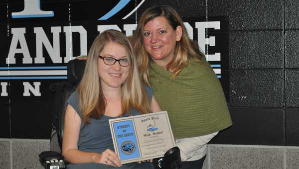 Catherine O'Hare, pictured right with her daughter Amelia, recently received the Shire Brave Award. (Contributed.)