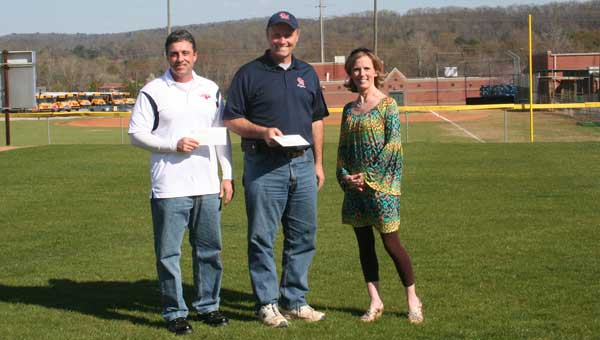 Tim O'Brien, representing Oak Mountain Youth Football and Cheerleading, Pat Rakers, representing Oak Mountain Youth Baseball and Softball, and Brandy Rhodes, OMIS PTO President, were involved in the OMIS Field Makeover Project. (Contributed photo.)