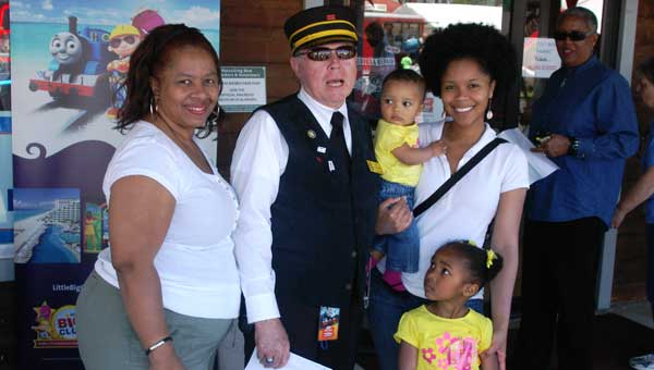 Thomas the Train recently visited the Heart of Dixie Railroad Museum. From left,  Seymour Johnson, Heart of Dixie Railroad Museum President Jim Garnett,  Seymour Barton, Summer Rose Johnson and Serenity Johnson. (Photo by Linda Long.)